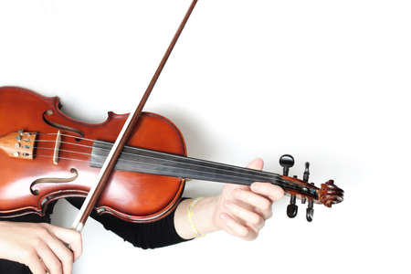 Violin player isolated on white. Violinist hands with violin and bow Banco de Imagens