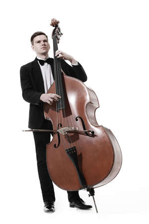 Double bass player playing contrabass Classical musician isolated on white Фото со стока