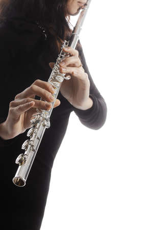 Flute player. Flutist playing flute instrument hands isolated on white Stock Photo