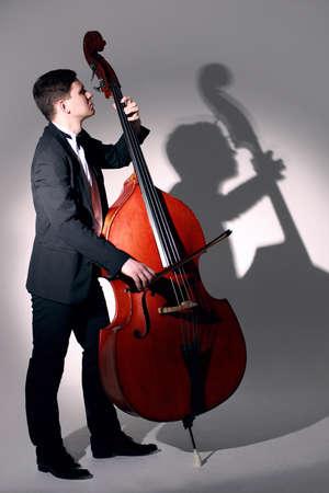Double bass player playing contrabass Jazz musician