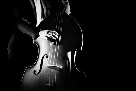 Double bass player playing contrabass musical instrument. Classical musician