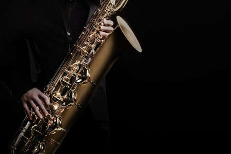 Saxophone player jazz music instrument. Sax player saxophonist with baritone