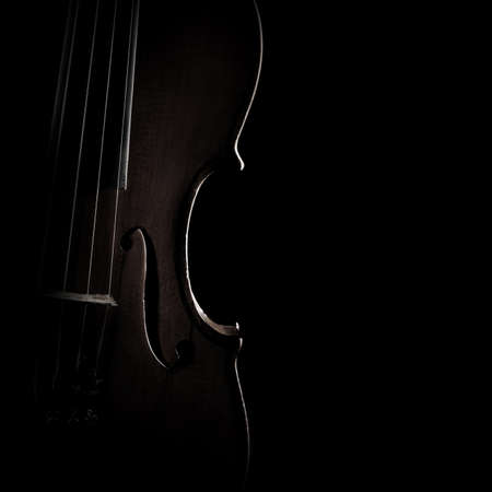 Violin close up Classical music instruments. Silhouette of violin isolated on black background closeup