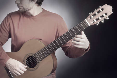 Classical guitar player. Classic guitarist playing acoustic guitar music instrument
