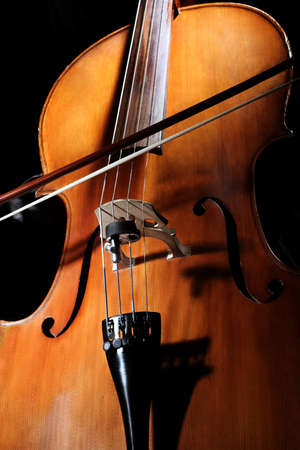 Cello player Cellist hands playing cello with bow orchestra musical instruments Stock Photo