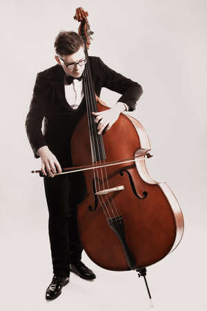 Double bass player playing contrabass Classical musician