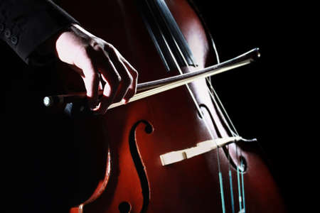 Double bass player Hands playing contrabass musical instrument Stock Photo