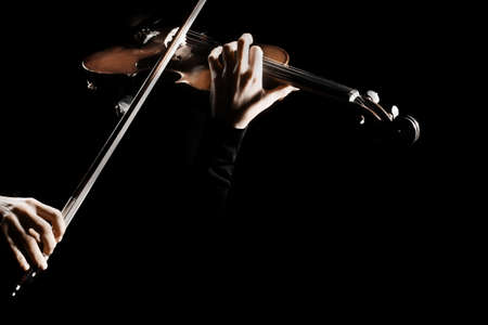 Violin player. Violinist playing violin hands bow music instrument isolated