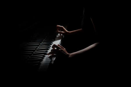 Piano player. Pianist hands playing grand piano Music instrument close up keys