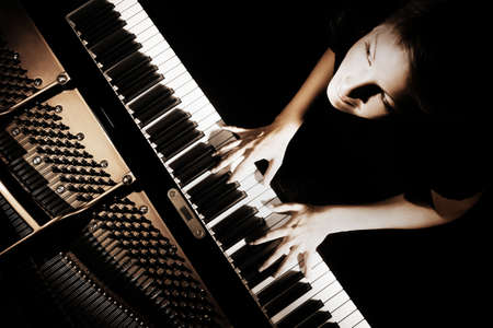 Piano player. Pianist playing grand piano concert. Musical instruments