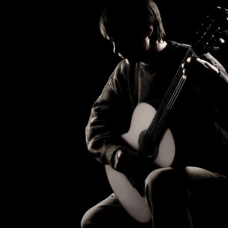 Acoustic guitar player guitarist. Classical guitar playing music instrument isolated