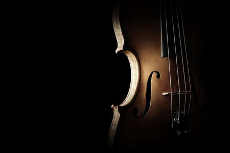 Violin closeup Musical instruments of orchestra. Silhouette violin isolated on black background close up