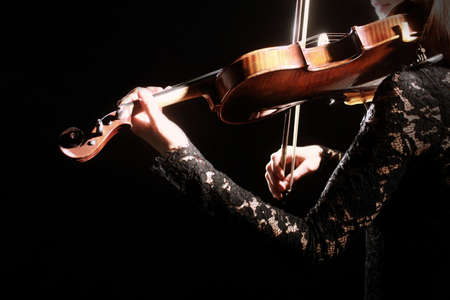 Violin player. Violinist playing violin Hands with musical instrument