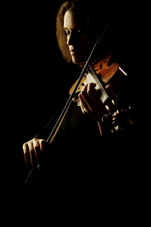 Violin player. Violinist playing violin isolated on black classical musician Standard-Bild