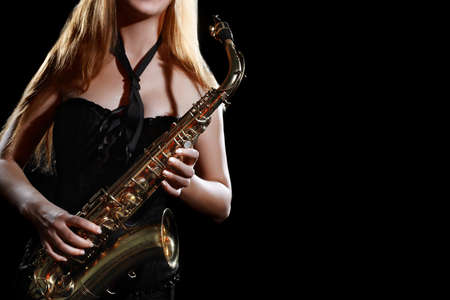 Saxophone player. Saxophonist woman Sax player with musical instrument Jazz musician