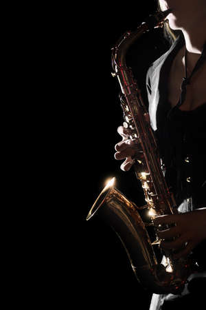 Saxophone Player Saxophonist playing jazz music. Sax player hands with music instrument closeup
