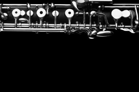 Oboe music instrument woodwind close up isolated on black background Stock Photo
