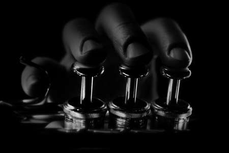 Trumpet player. Hands playing brass instrument Trumpeter isolated close up Standard-Bild