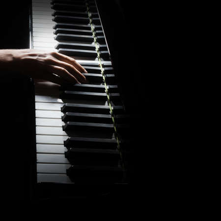 Piano player. Pianist hands piano grand music instrument close up keyboard Standard-Bild