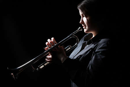 Trumpet player. Woman trumpeter playing Jazz musician with brass instrument Standard-Bild