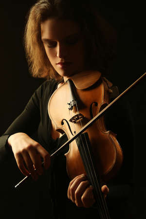 Violin player. Violinist playing violin classical musician woman Stock Photo