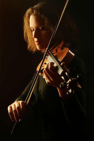 Violin player. Violinist playing violin classical musician woman Standard-Bild