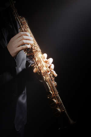 Saxophone player with music instrument Saxophonist playing sax soprano