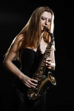 Saxophone player. Saxophonist woman playing Sax player jazz musician Standard-Bild