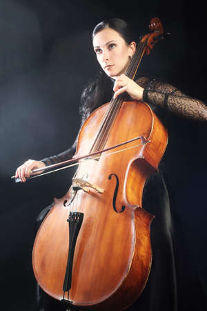 Cello player. Cellist woman playing violoncello classical musician 写真素材