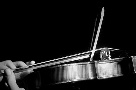 Violin strings with bow. Hands of violin player close up. Violinist with music instrument