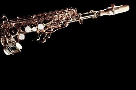 Saxophone jazz instrument sax soprano. Jazz music instrument isolated on black background