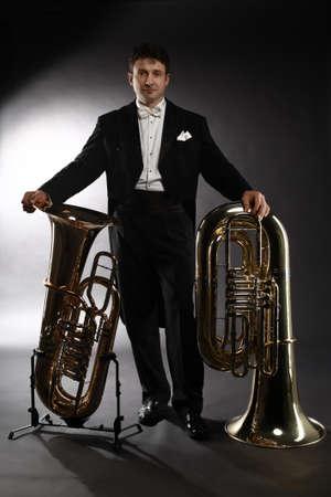 Tuba brass instrument. Classical musician portrait man horn player. Orchestra instrument bass euphonium Standard-Bild