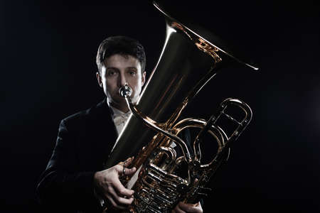 Tuba brass instrument. Classical musician portrait man horn player. Orchestra instrument bass euphonium