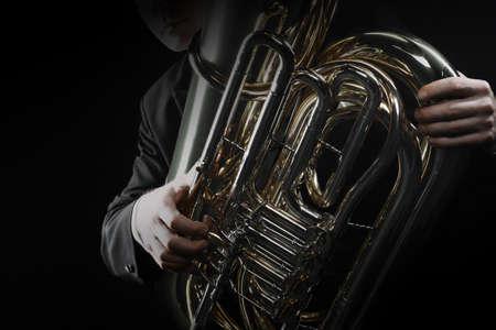 Tuba brass instrument. Wind music horn player. Orchestra instrument bass euphonium