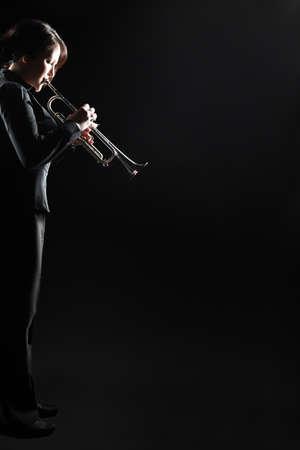 Trumpet player jazz musician playing brass instrument. Jazz trumpeter