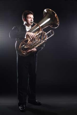 Tuba player brass instrument. Classical musician man horn player. Orchestra instrument bass euphonium Standard-Bild