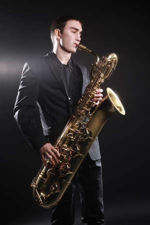 Saxophone player Jazz musician. Baritone sax player blues music playing saxophonist