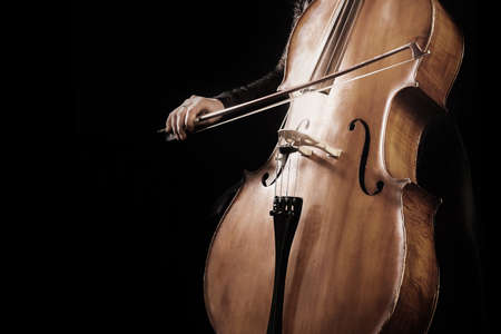 Cello player. Hands cellist playing violoncello orchestra musical instruments
