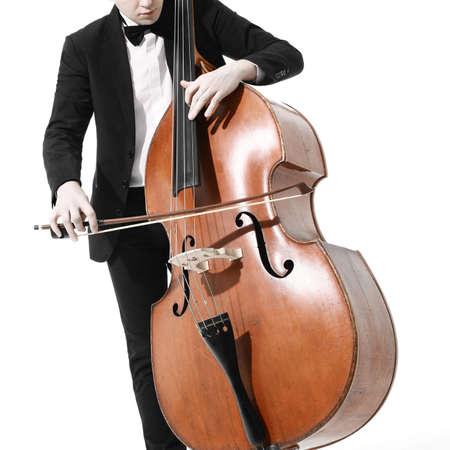 Double bass player. Hands playing contrabass String musical instrument Standard-Bild