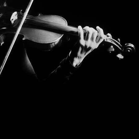 Close-up view of a violinist playing the music instrument.