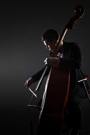 Classical double bass player contrabass playing.