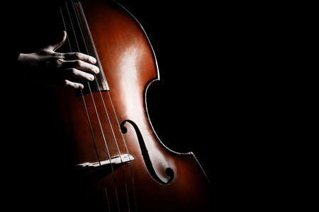 Double bass. Hands playing contrabass player musical instrument. Strings cello Banque d'images - 97518411