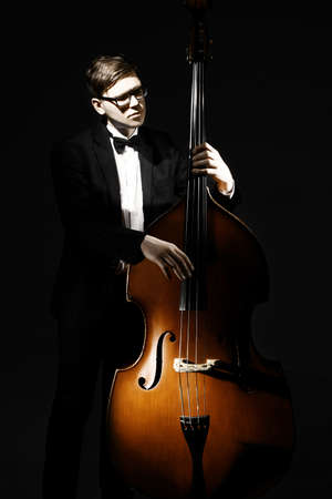 Double bass player contrabass playing. Classical musician jazz bassist Stock Photo