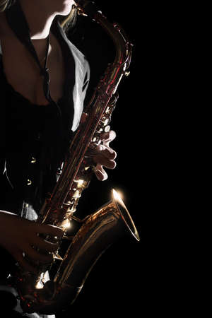 Saxophone Player Saxophonist playing jazz music. Sax player woman with music instrument closeup