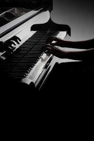Piano player. Pianist hands playing piano keyboard. Music instrument closeup grand piano keys