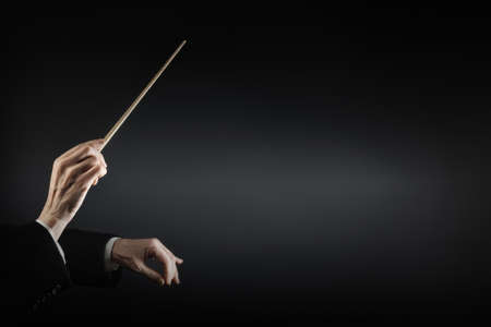 Orchestra conductor music conducting. Hands of conductor with baton. Maestro stick Stockfoto