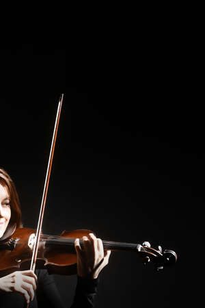 Violin player. Violinist playing violin hands closeup music instrument isolated on black background