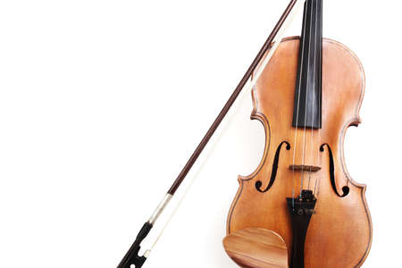 Violin closeup isolated on white background. String orchestra music instrument close up.