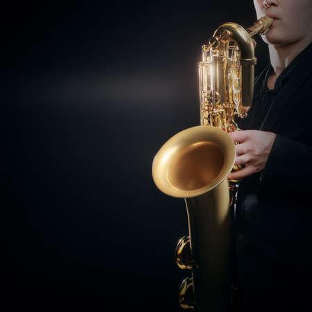 Saxophone player Jazz musician. Saxophonist playing jazz music. Baritone sax player closeup Stock Photo