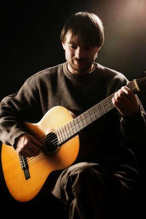 Acoustic guitar player. Classical guitarist playing guitar spanish closeup